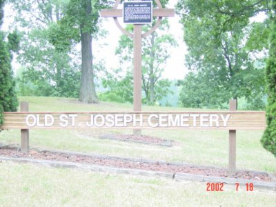 Picture of the Old St Joseph sign and Cross